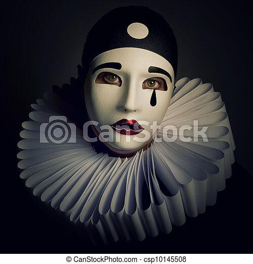 Pierrot mask on a black backgr...