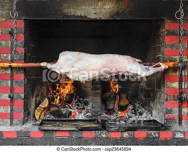 Pig on a spit - csp23645894
