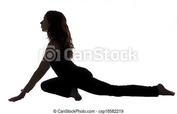 pigeon pose in yoga silhouette young woman is doing