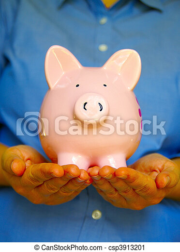 Piggy bank being held by two hands - csp3913201