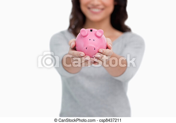 Piggy bank being held by woman - csp8437211