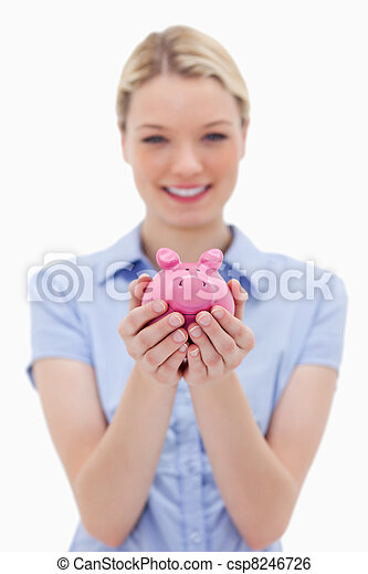 Piggy bank being held by young woman - csp8246726