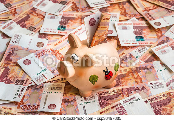 Piggy bank in a pile of russian five thousand banknotes - csp38497885