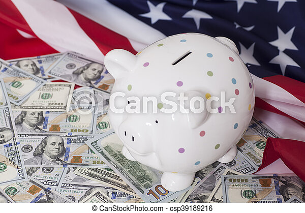 Piggy Bank on Dollars with American Flag - csp39189216