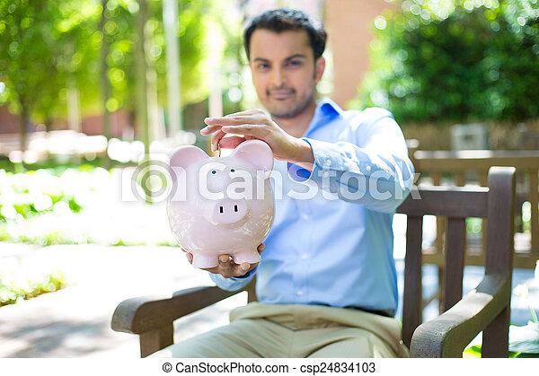 Piggy bank savings outside - csp24834103