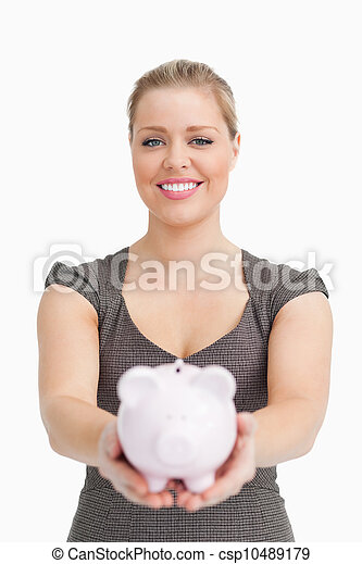 Piggy bank showing by a pretty woman - csp10489179