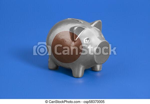 Piggy bank with Japan flag - csp58370005