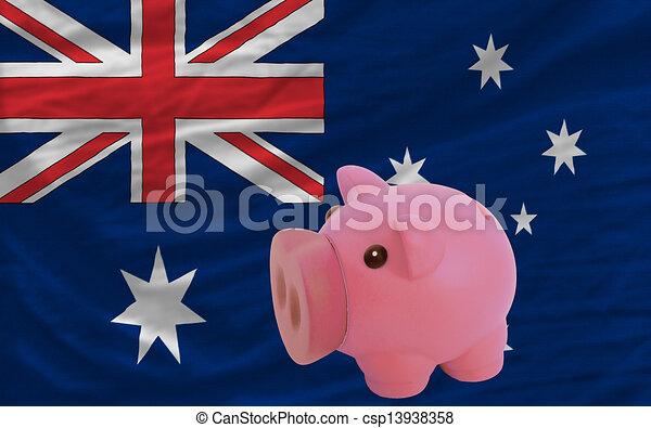 piggy rich bank and national flag of australia - csp13938358