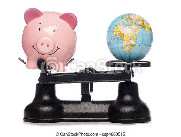 Piggybank and globe on scales - csp4680515