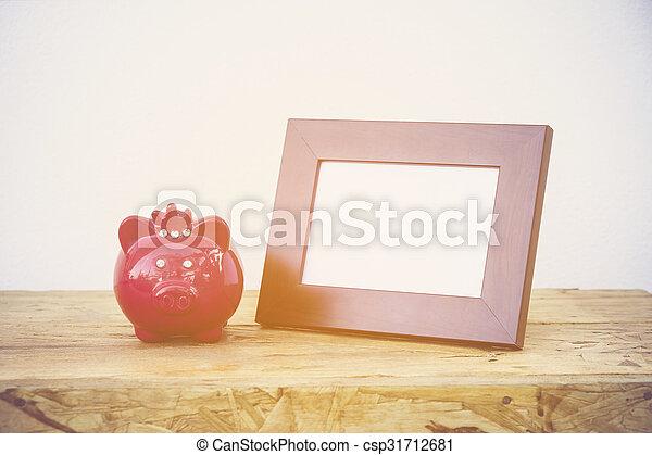 Piggybank saving plan education concept, photo frame, - csp31712681