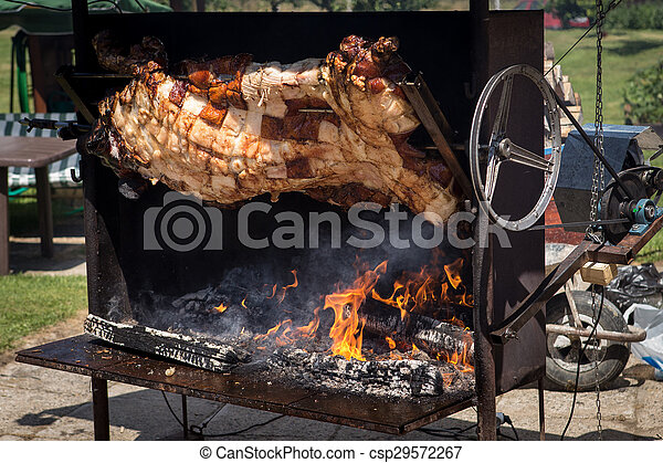 Piglet roasted on a spit - csp29572267