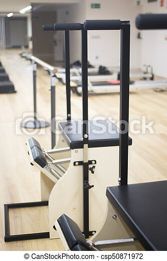 Pilates machine gym studio - csp50871972