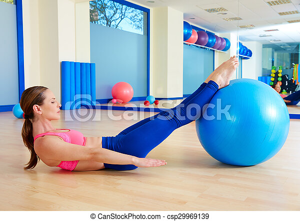 Pilates woman hundred fitball exercise workout - csp29969139