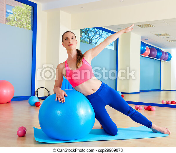 Pilates woman side bend fitball exercise - csp29969078