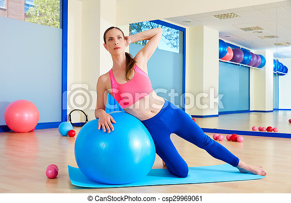 Pilates woman side bend fitball exercise - csp29969061