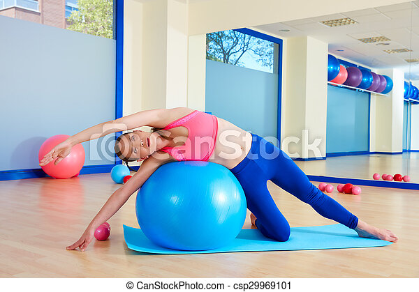 Pilates woman side bend fitball exercise - csp29969101