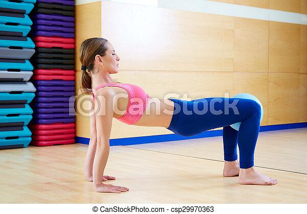 Pilates woman stability ball exercise gym workout - csp29970363