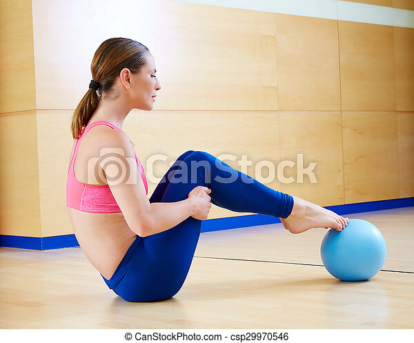 Pilates woman stability ball exercise gym workout - csp29970546