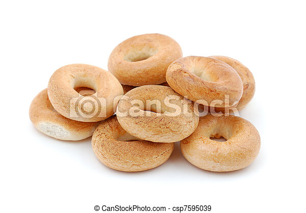 Pile of bagels isolated on white background - csp7595039