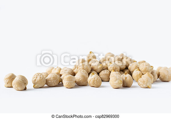 Pile of chickpeas on white background. Garbanzo beans traditional Near Easten food. - csp82969300