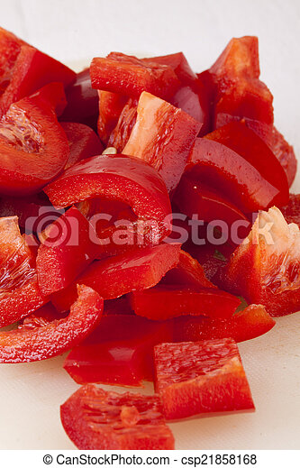 Pile of Chopped Red Pepper on Cutting Board - csp21858168