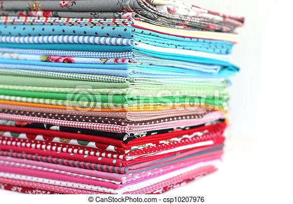 Pile of colorful cotton textile  background - csp10207976