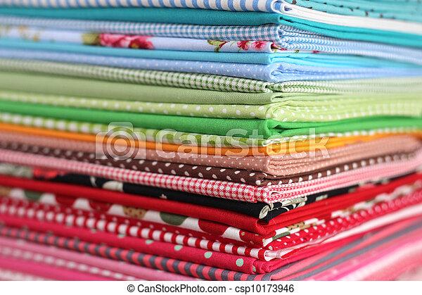 Pile of colorful cotton textile  background - csp10173946