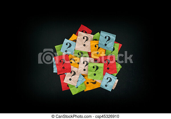 Pile of colorful paper notes with question marks on blackboard - csp45326910