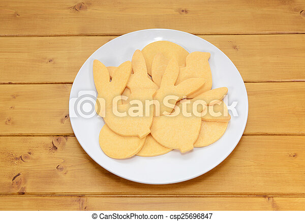Pile of cookies in Easter-themed shapes - csp25696847