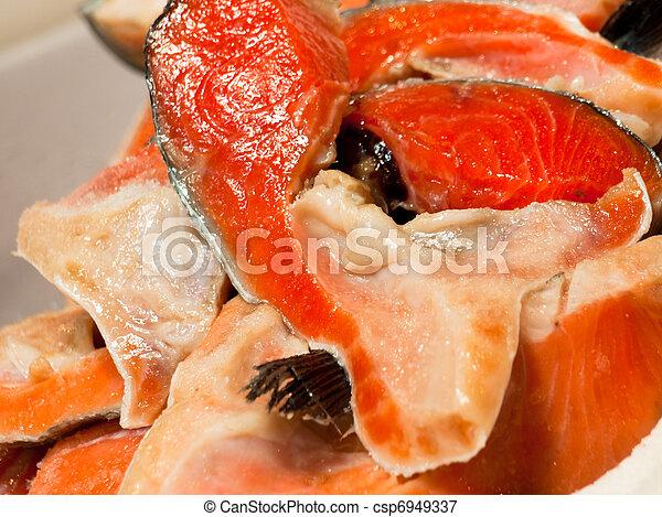 Pile of cut salmon - csp6949337