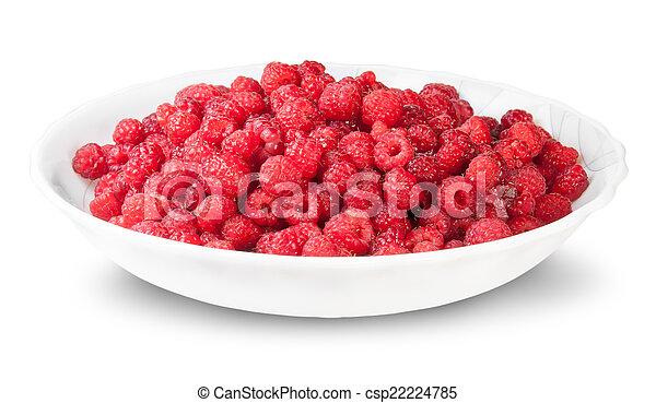 Pile Of Fresh Raspberries On A White Plate - csp22224785