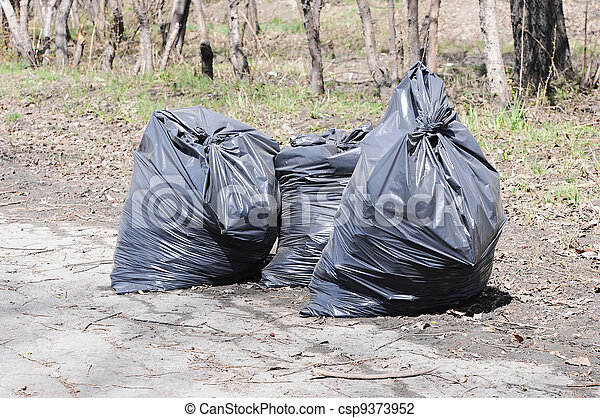 Pile of garbage on green grass in the nature environment problems - csp9373952