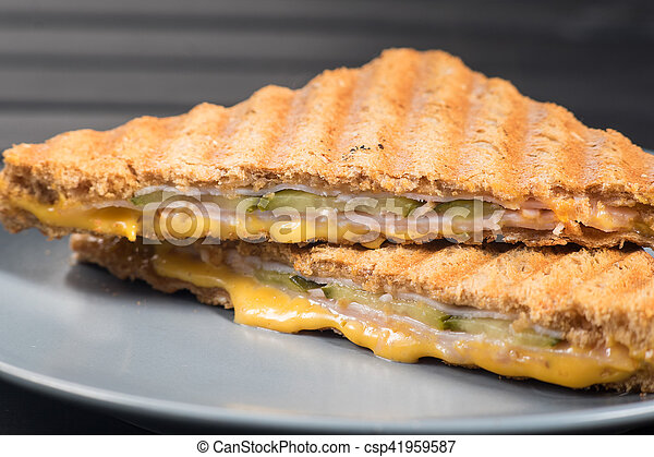 Pile of grilled sandwiches with cheese and ham. - csp41959587