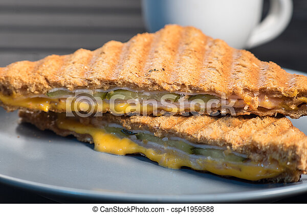 Pile of grilled sandwiches with cheese and ham. - csp41959588