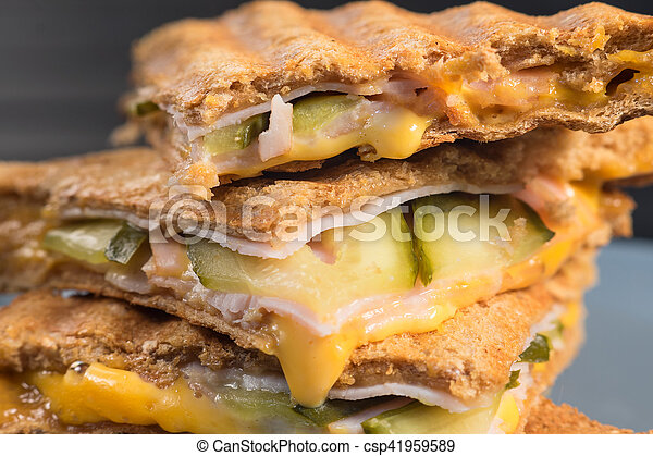 Pile of grilled sandwiches with cheese and ham. - csp41959589
