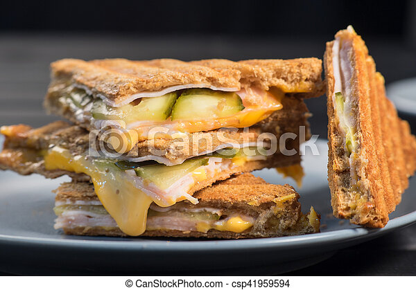 Pile of grilled sandwiches with cheese and ham. - csp41959594