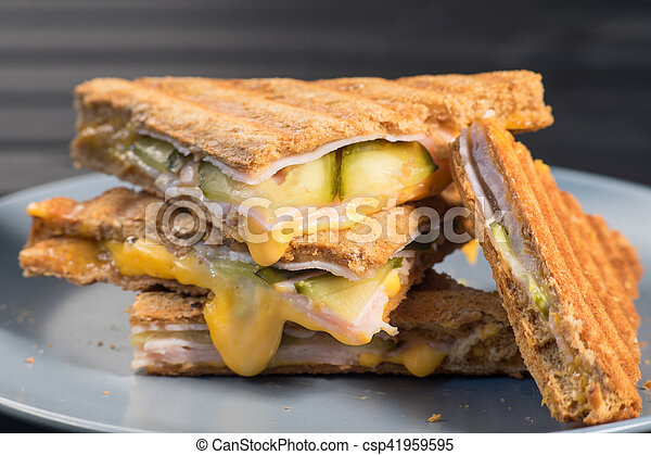 Pile of grilled sandwiches with cheese and ham. - csp41959595