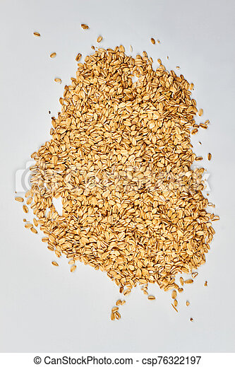 Pile of oat flakes on white background. - csp76322197