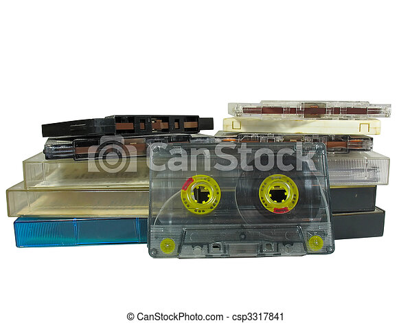 pile of old audio cassetes isolated over white - csp3317841