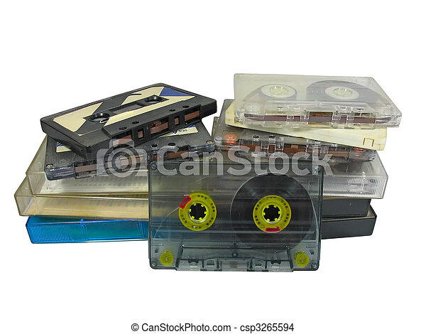 pile of old audio cassetes isolated over white - csp3265594