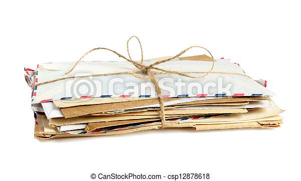 Pile of old envelopes isolated on white background - csp12878618