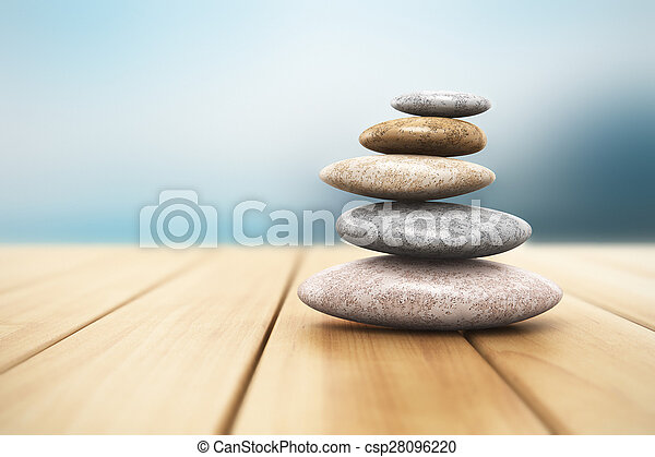 Pile of pebbles on wooden planks - csp28096220