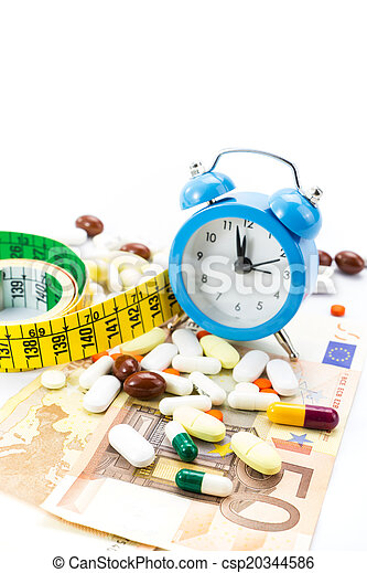 Pile of pills with banknotes, clock - csp20344586