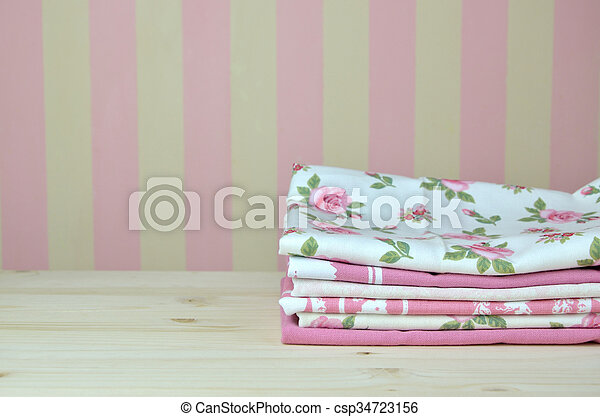Pile of Pink Kitchen Towels - csp34723156