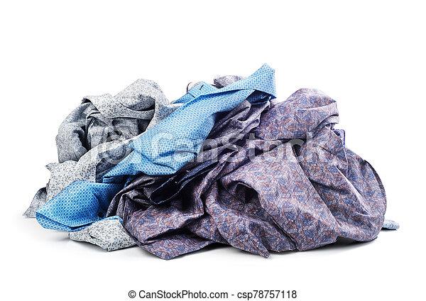 Pile of shirts isolated on white background - csp78757118
