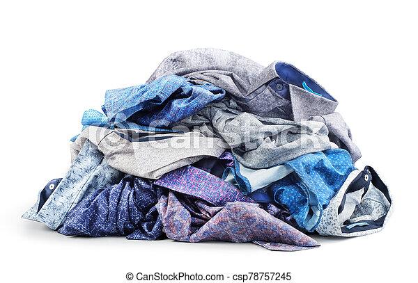 Pile of shirts isolated on white background - csp78757245