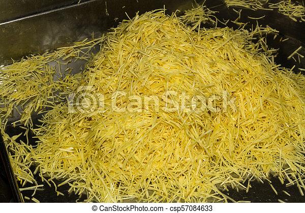 Pile of shredded ginger - csp57084633