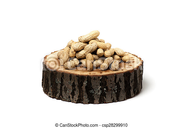 Pile of unshelled peanuts, isolated on white background - csp28299910