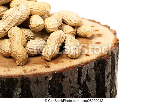 Pile of unshelled peanuts, isolated on white background - csp28299912