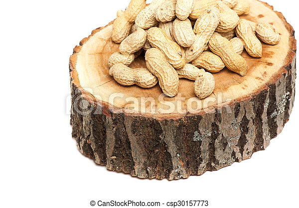 Pile of unshelled peanuts, isolated on white background - csp30157773